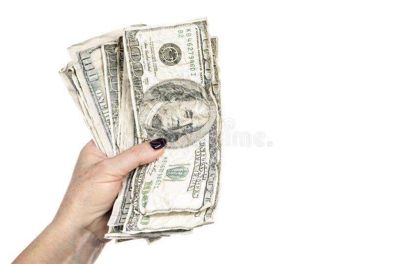 Dólares amarrotados na mão fêmea fotos de stock