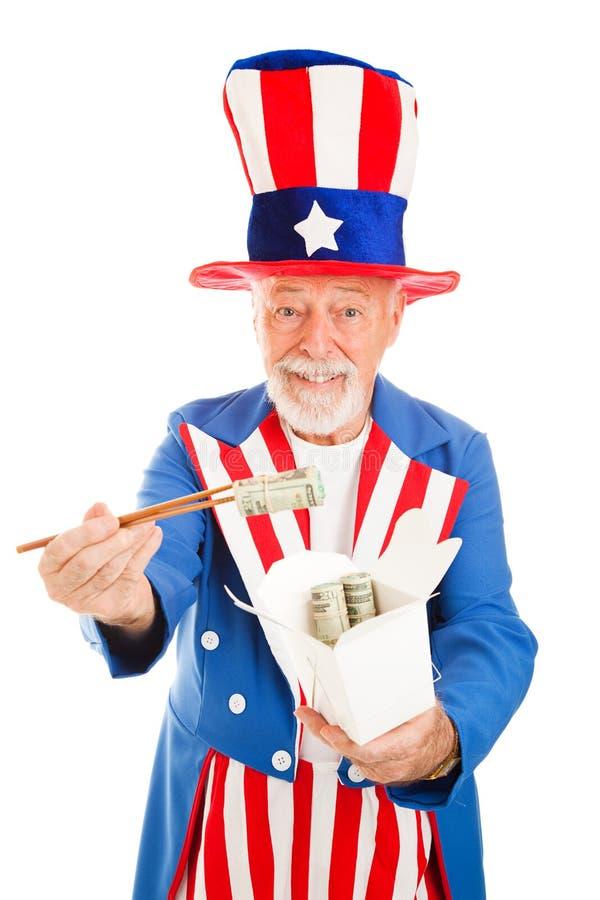 Dólares americanos A China foto de stock royalty free
