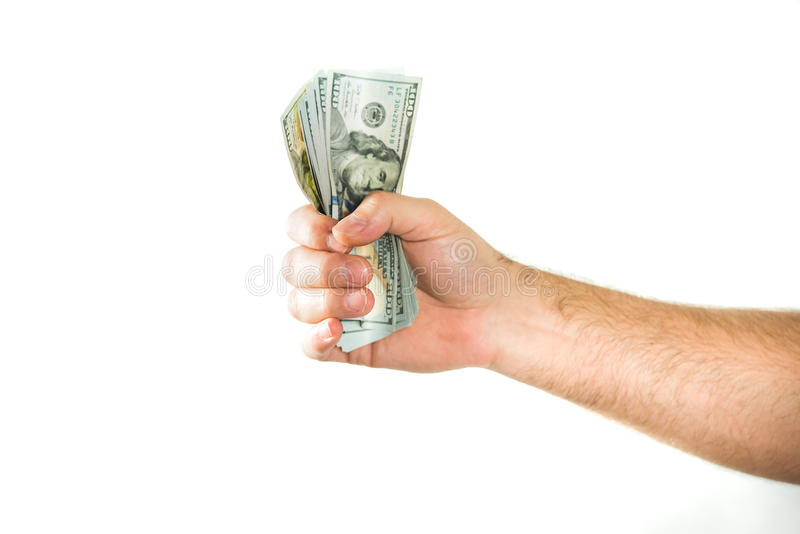 Dólares americanos da moeda Um punhado apertado com dinheiro imagens de stock royalty free