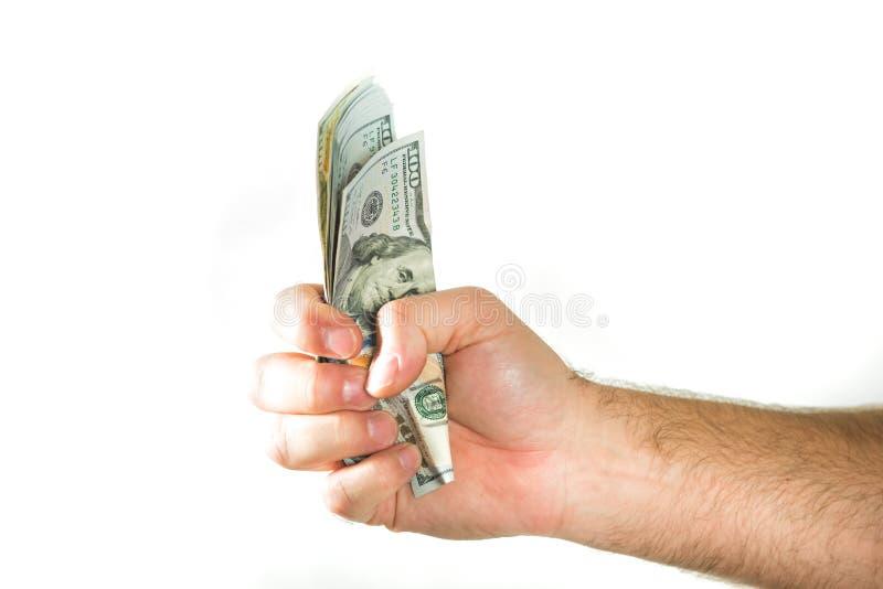 Dólares americanos da moeda Um punhado apertado com dinheiro fotos de stock