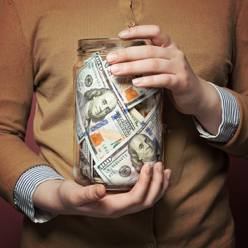 Dólares americanos descontam dentro o frasco imagens de stock