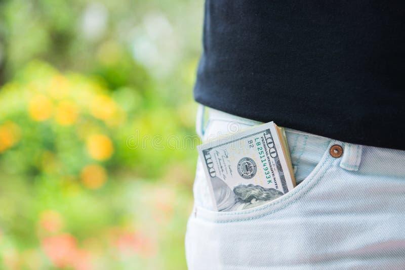 Dólares americanos do dinheiro no bolso imagens de stock