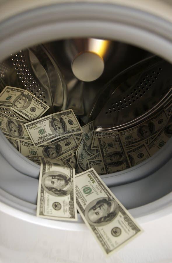 Dólares americanos na máquina de lavar imagens de stock royalty free