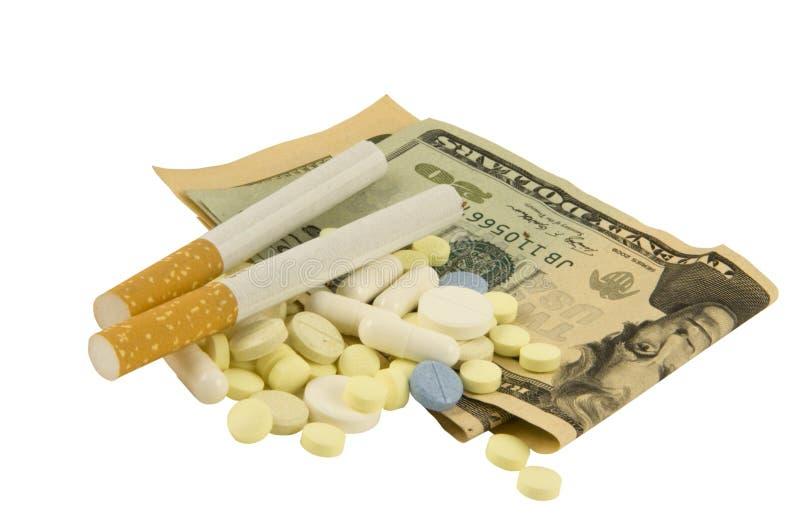 Dólares, comprimidos, cigarro fotos de stock