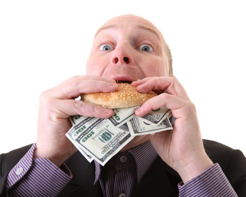 Dólares consumidores de la avaricia de la avaricia imágenes de archivo libres de regalías