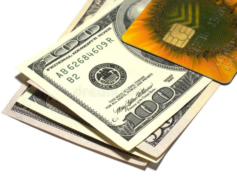 Dólares e cartão de crédito fotografia de stock royalty free