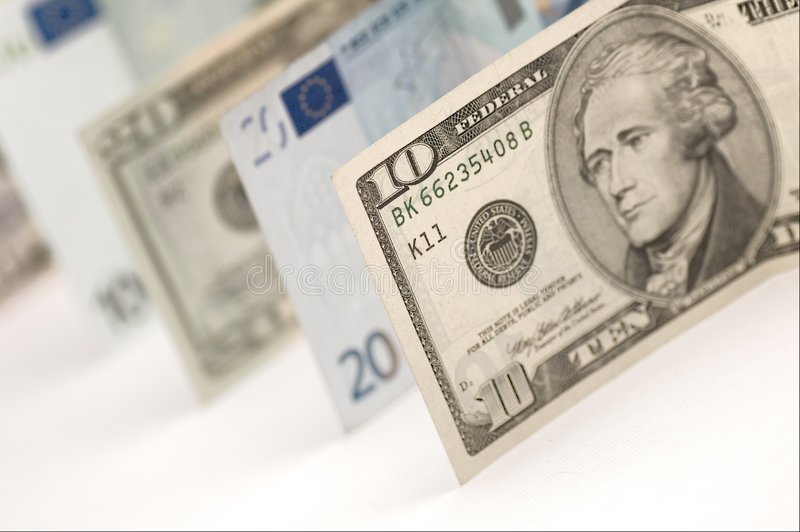 Dólares e euro foto de stock