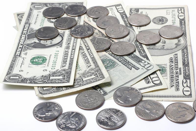Dólares e moedas imagens de stock royalty free