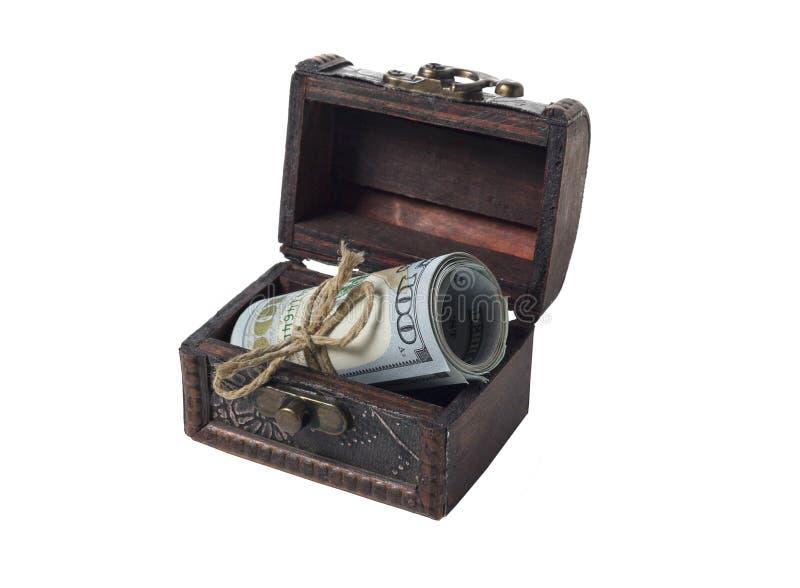 Dólares em um rolo em uma caixa retro imagem de stock royalty free
