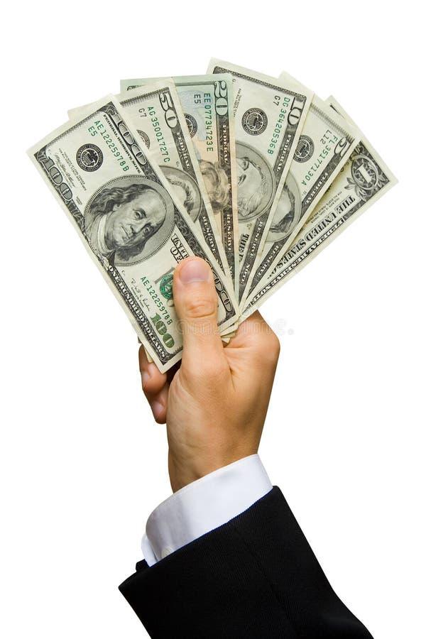 Dólares em uma mão foto de stock