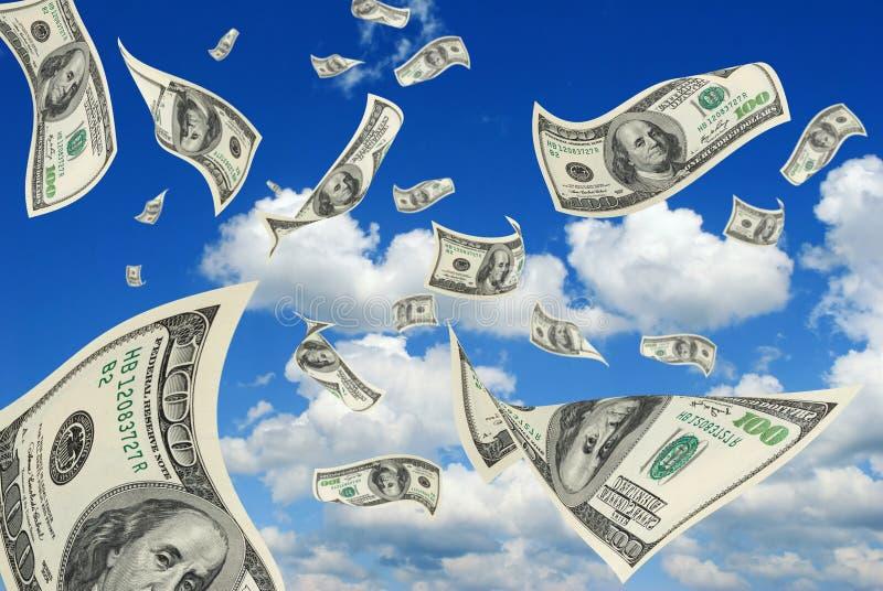 Dólares en cielo. imagen de archivo