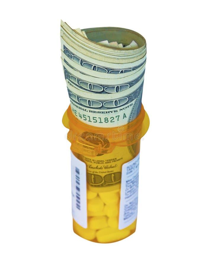 Dólares en una botella de la prescripción imagen de archivo