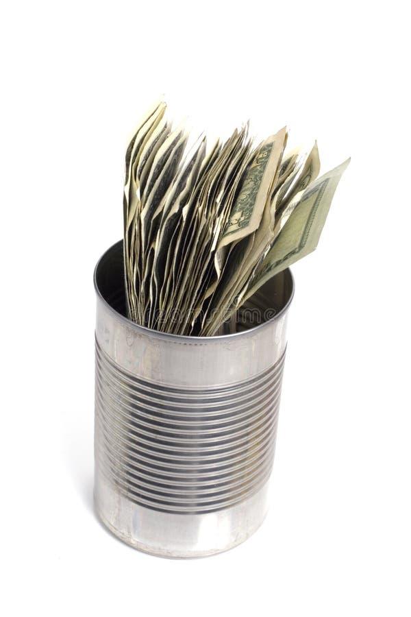 Dólares en una poder de estaño foto de archivo libre de regalías