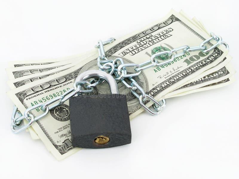 Dólares, encadenados y bloqueados fotografía de archivo