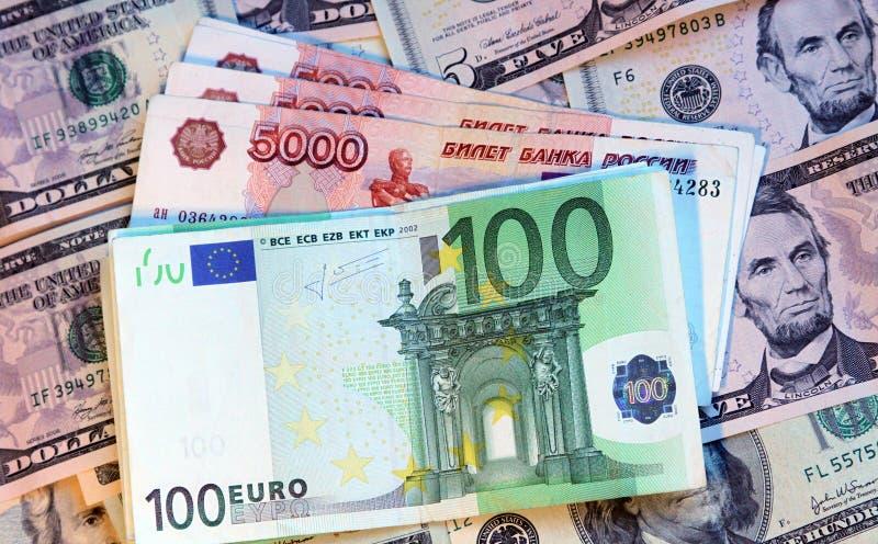 Dólares, euro e rublos russian modernos imagens de stock