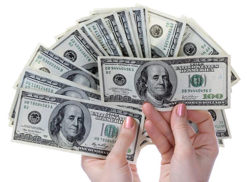 Dólares nas mãos. foto de stock