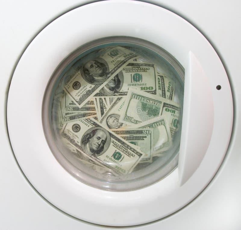 Dólares que lavan planchan imagen de archivo