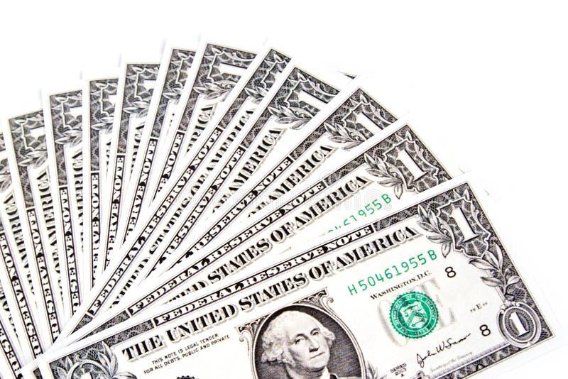 Dólares separados en el fondo blanco fotografía de archivo libre de regalías