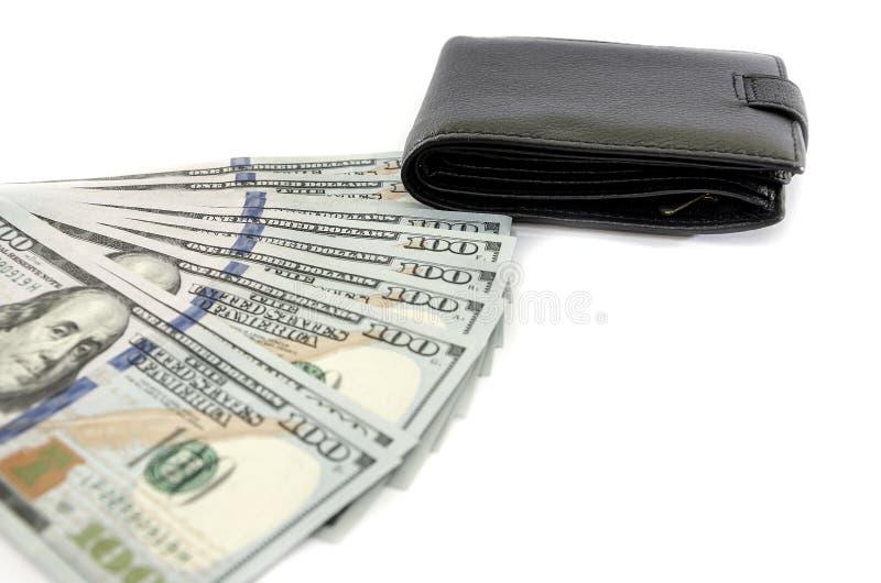 Dólares y cartera negra aislados en el fondo blanco imagen de archivo libre de regalías