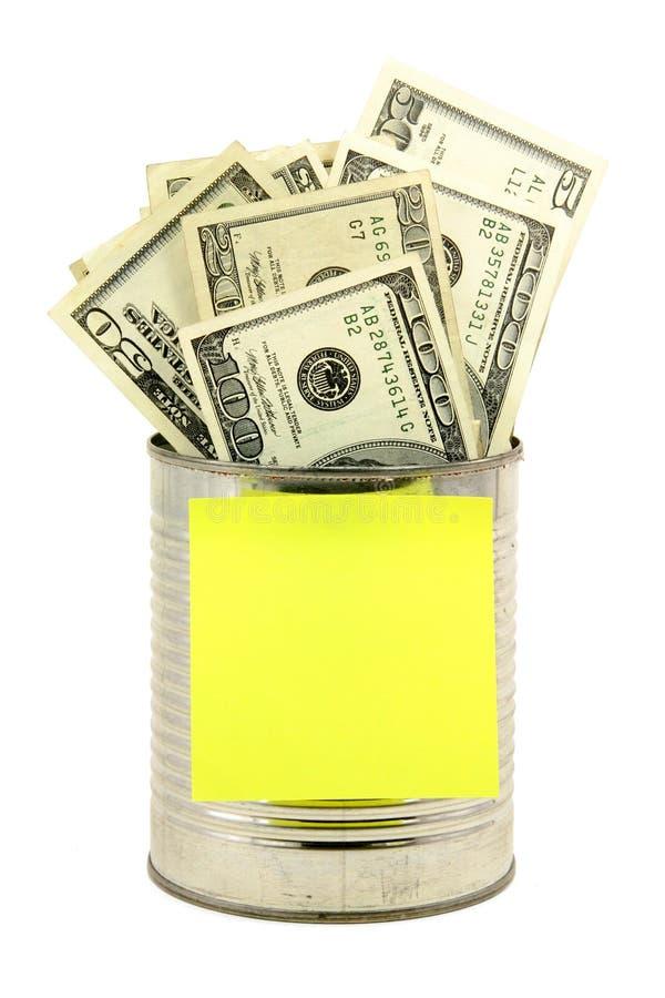 Dólares y estaño foto de archivo