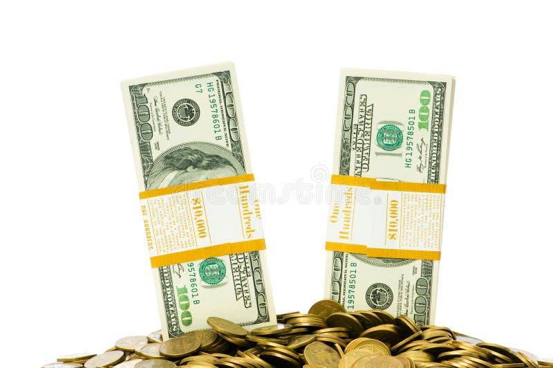 Dólares y monedas aislados