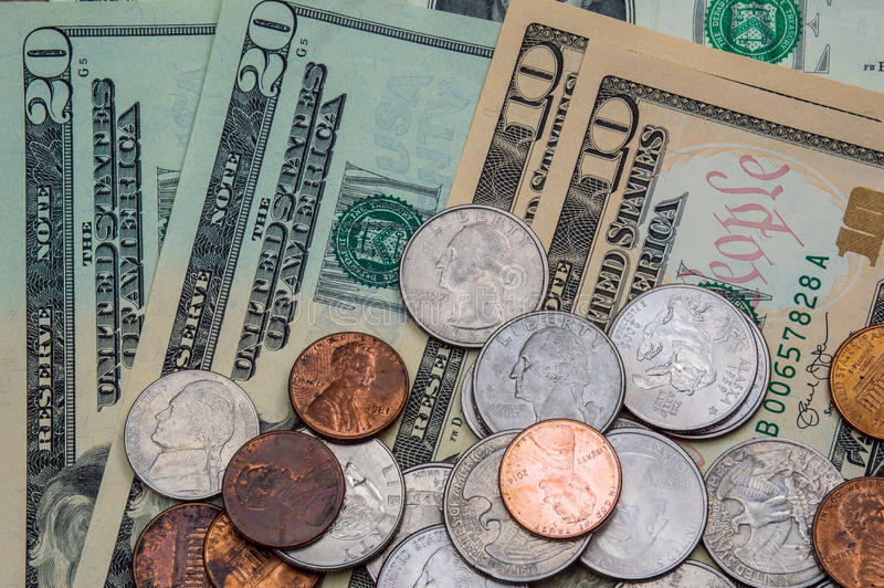 Dólares y monedas de Estados Unidos imagen de archivo libre de regalías