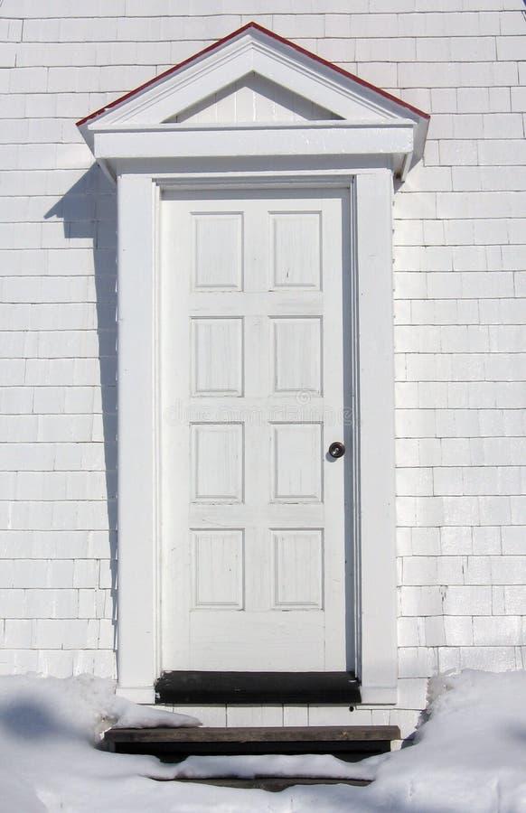 dörren skriver in white arkivbilder