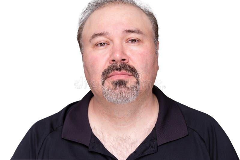 Düsterer schauender Mann von mittlerem Alter stockfoto