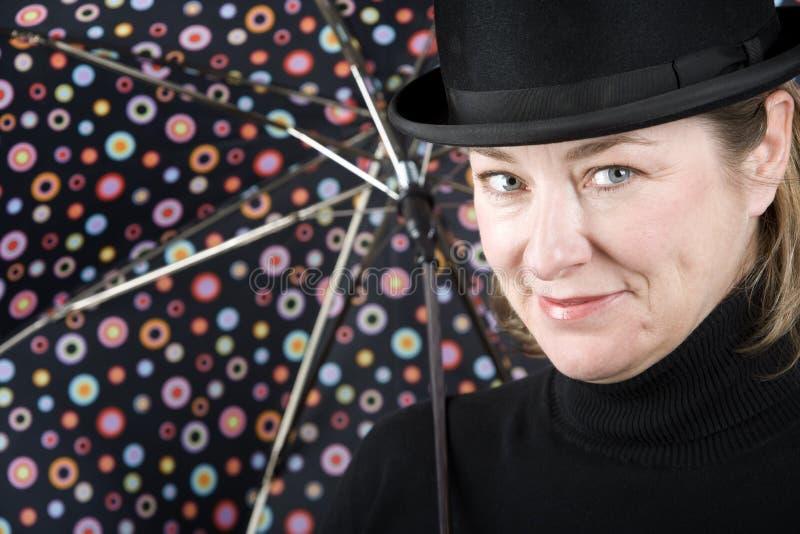 dęciaka kapeluszu parasola kobieta zdjęcie royalty free