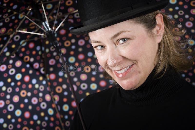 dęciaka kapeluszu parasola kobieta fotografia royalty free
