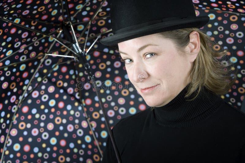 dęciaka kapeluszu parasola kobieta zdjęcia stock