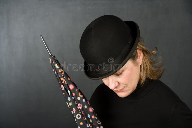 dęciaka kapeluszu parasola kobieta obrazy stock