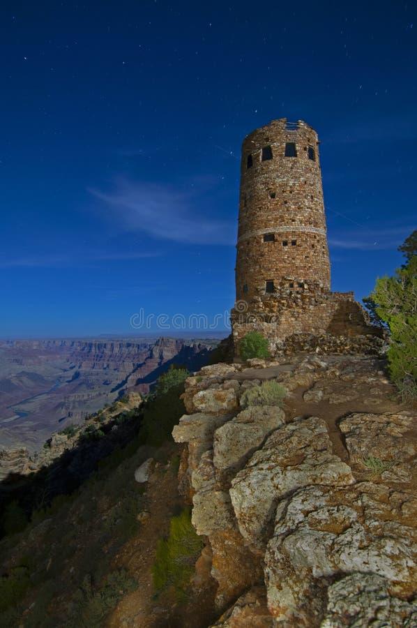 Długi ujawnienie wieża obserwacyjna w Grand Canyon przy nocą fotografia stock