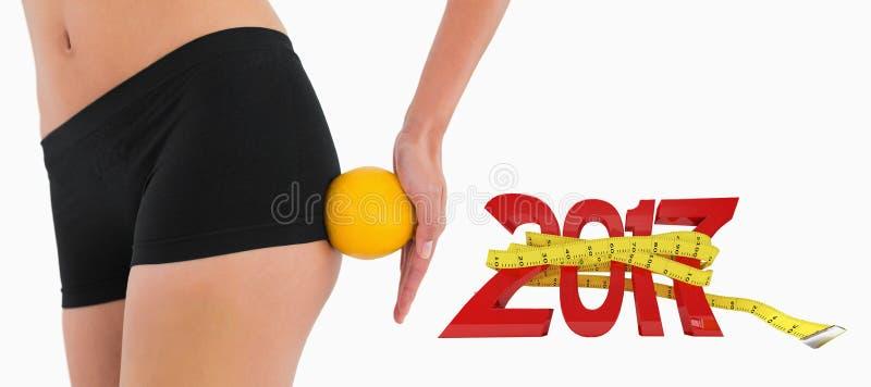3D女性屁股的综合图象有橙色辗压的对此 免版税库存照片