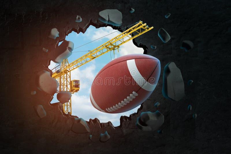3d运载美式足球的卵形球和打破在黑墙壁的卷扬起重机翻译孔有天空蔚蓝的 库存图片