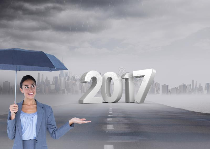 3D 2017 against composite image of woman holding an umbrella on road. In city stock image