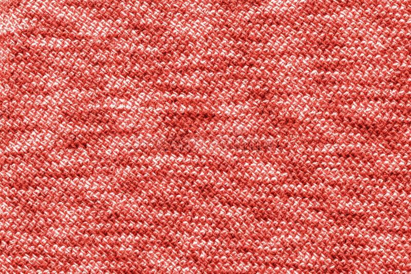 D'avanguardia tricottato del tessuto del jersey colorato dell'anno 2019, fondo di corallo di colore, struttura fotografia stock