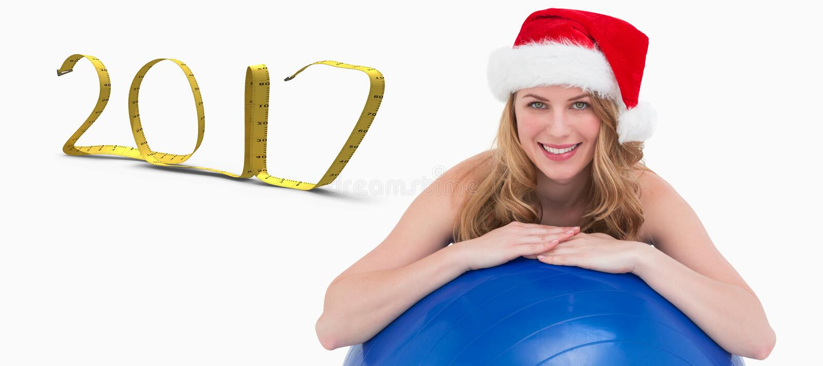 3D Composite image of festive fit blonde leaning on exercise ball stock images
