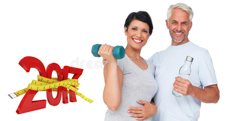 3D Composite image of happy fit couple with dumbbell and water bottle royalty free stock photos