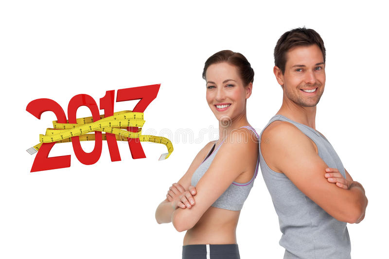 3D Composite image of portrait of a happy fit young couple with hands crossed royalty free stock images