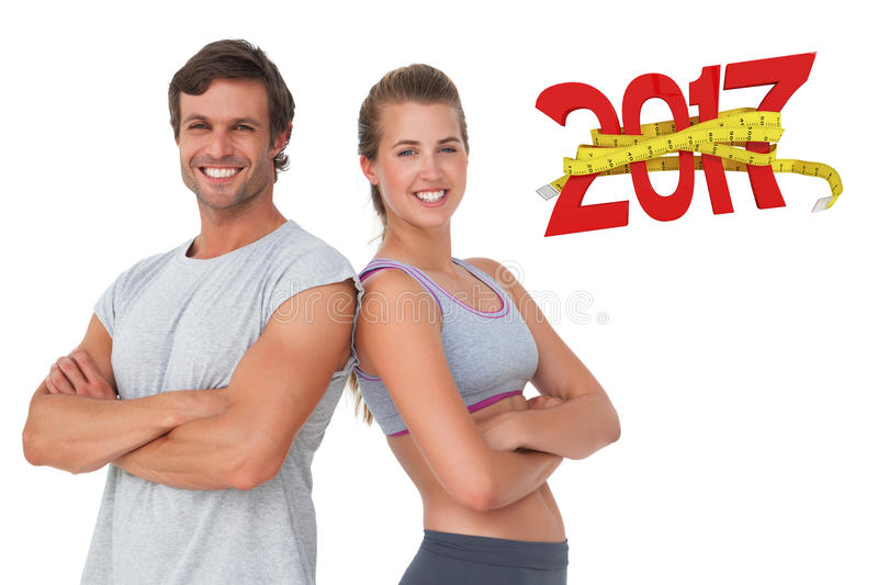 3D Composite image of portrait of a sporty young couple with arms crossed royalty free stock photo