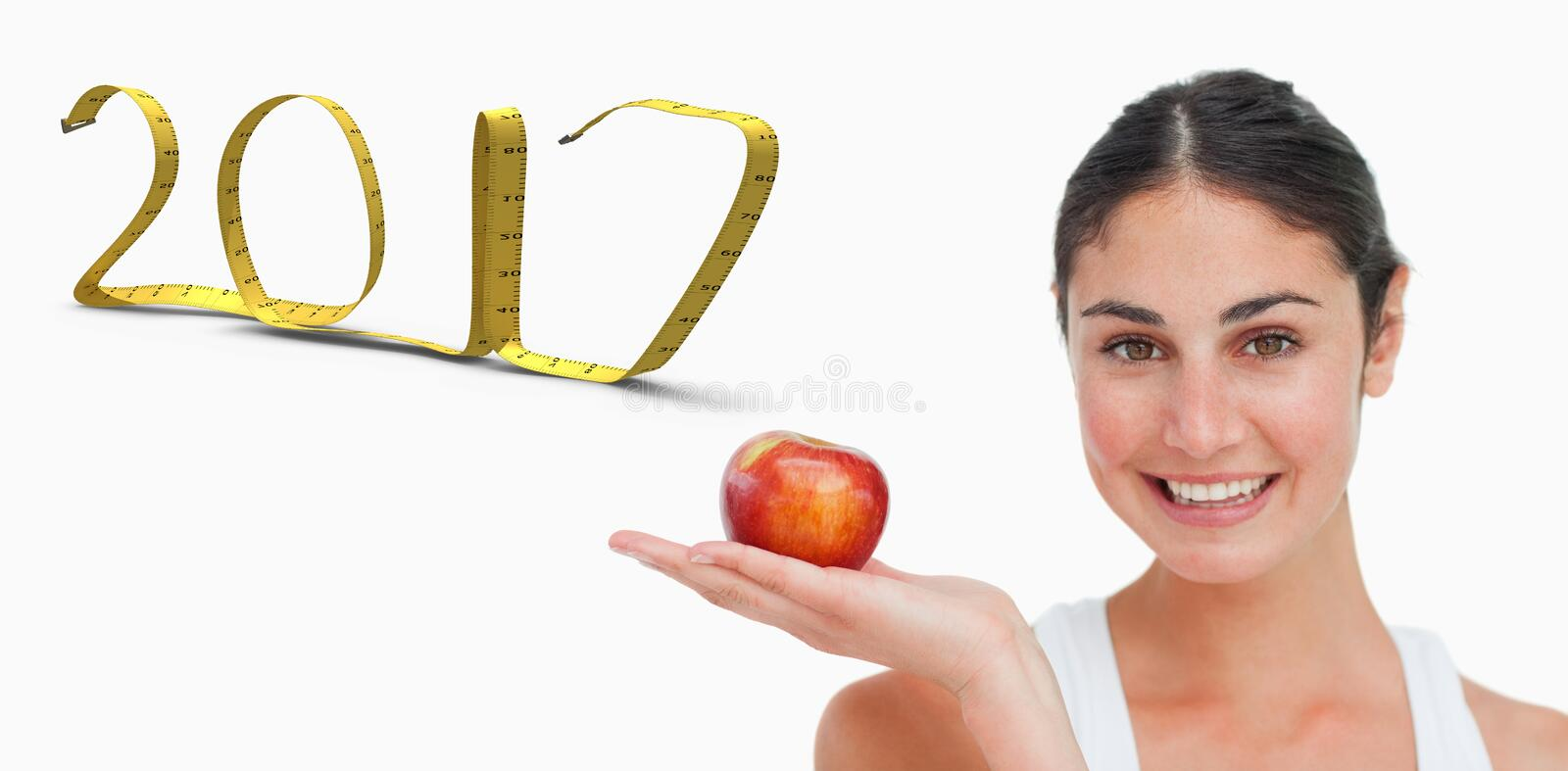 3D Composite image of woman on diet with an apple in the hand stock photos