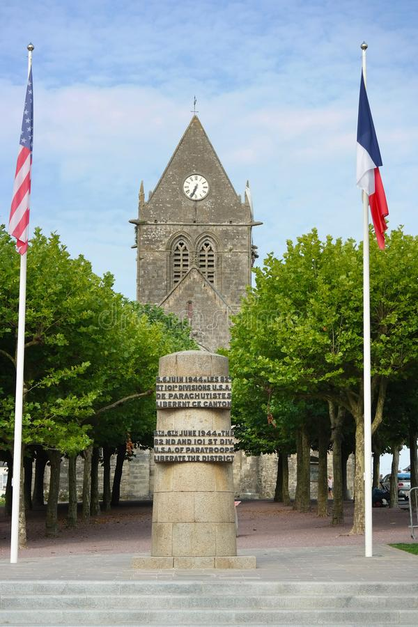 D-Day liberation memorial. D-Day liberation monument in front of the church of Sainte-Mère-Église.Text on memorial: 5th.6th JUNE 1944. THE 82nd AND 101st stock photos