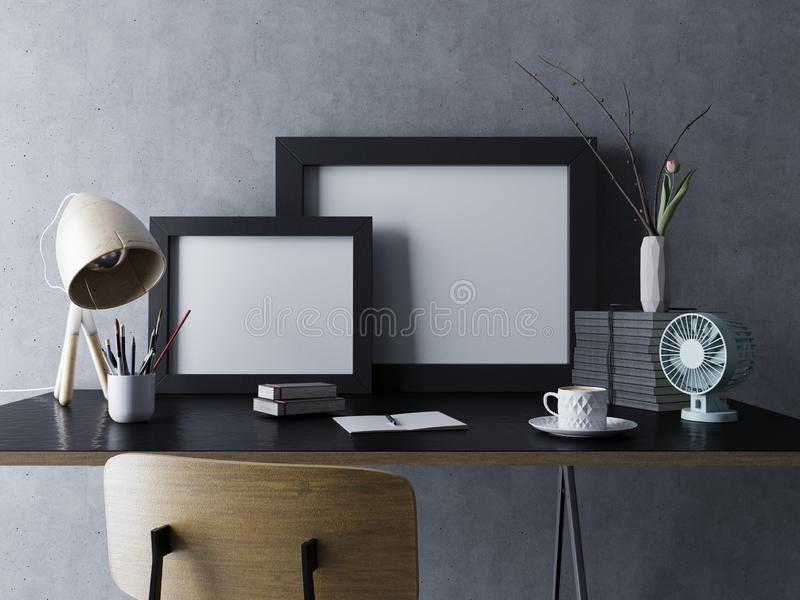 mock up of two empty white poster template in black frame in modern home office workspace interior in standing on table royalty free illustration