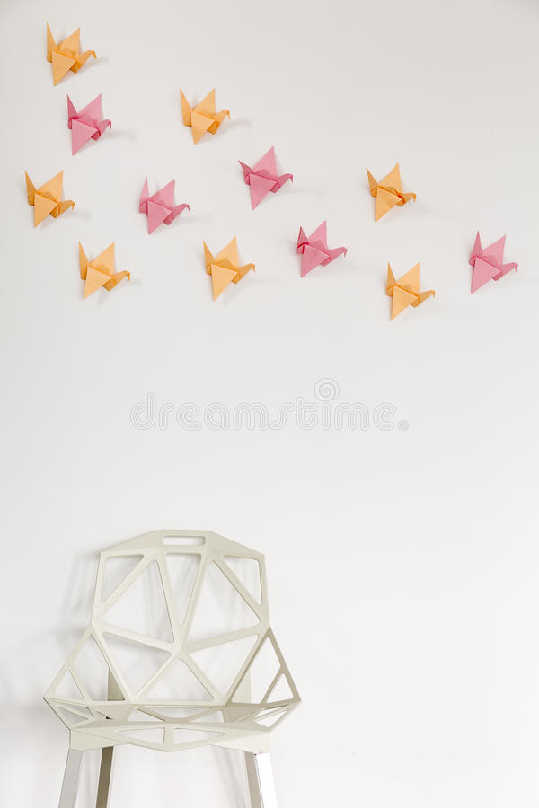 3D DIY wall decor idea. Light home interior with modern crystal chair and origami wall decor stock photography