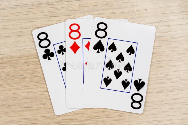 3 d'eights aimables 8 - casino jouant aux cartes de tisonnier photos stock