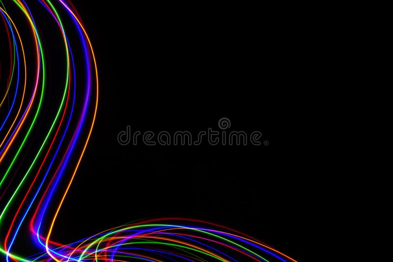 3D illustration. Abstract patterns of lights on black background. Lines of colors, luminous strokes stock images