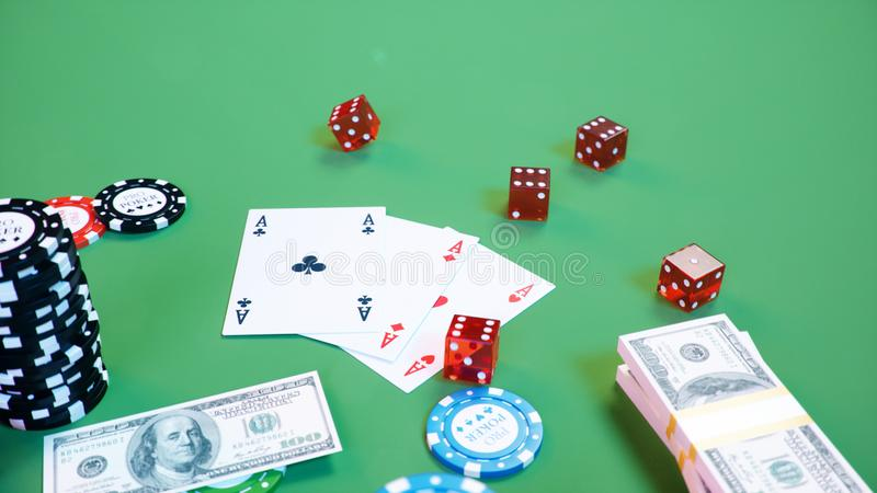 3D illustration casino game. Chips, playing cards for poker. Poker chips, red dice and money on green table. Online. Casino concept stock illustration