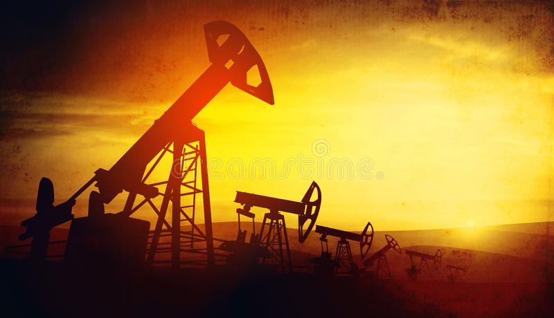 3d illustration of oil pump jacks on sunset background. 3d illustration of oil pump jacks on sunset sky background stock photo