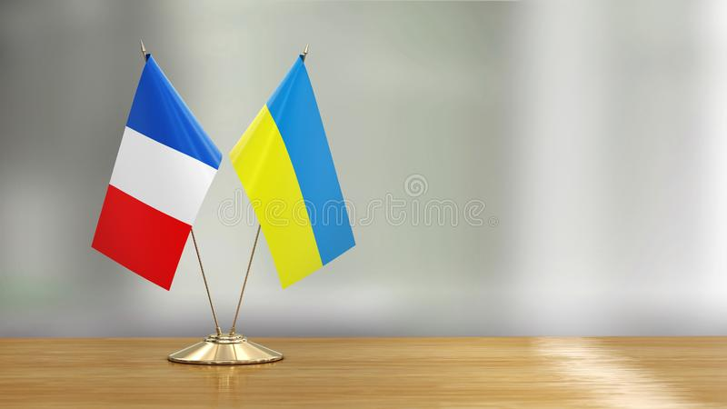 French and Ukrainian flag pair on a desk over defocused background. 3d Image of French and Ukrainian flag pair on a desk over defocused background vector illustration